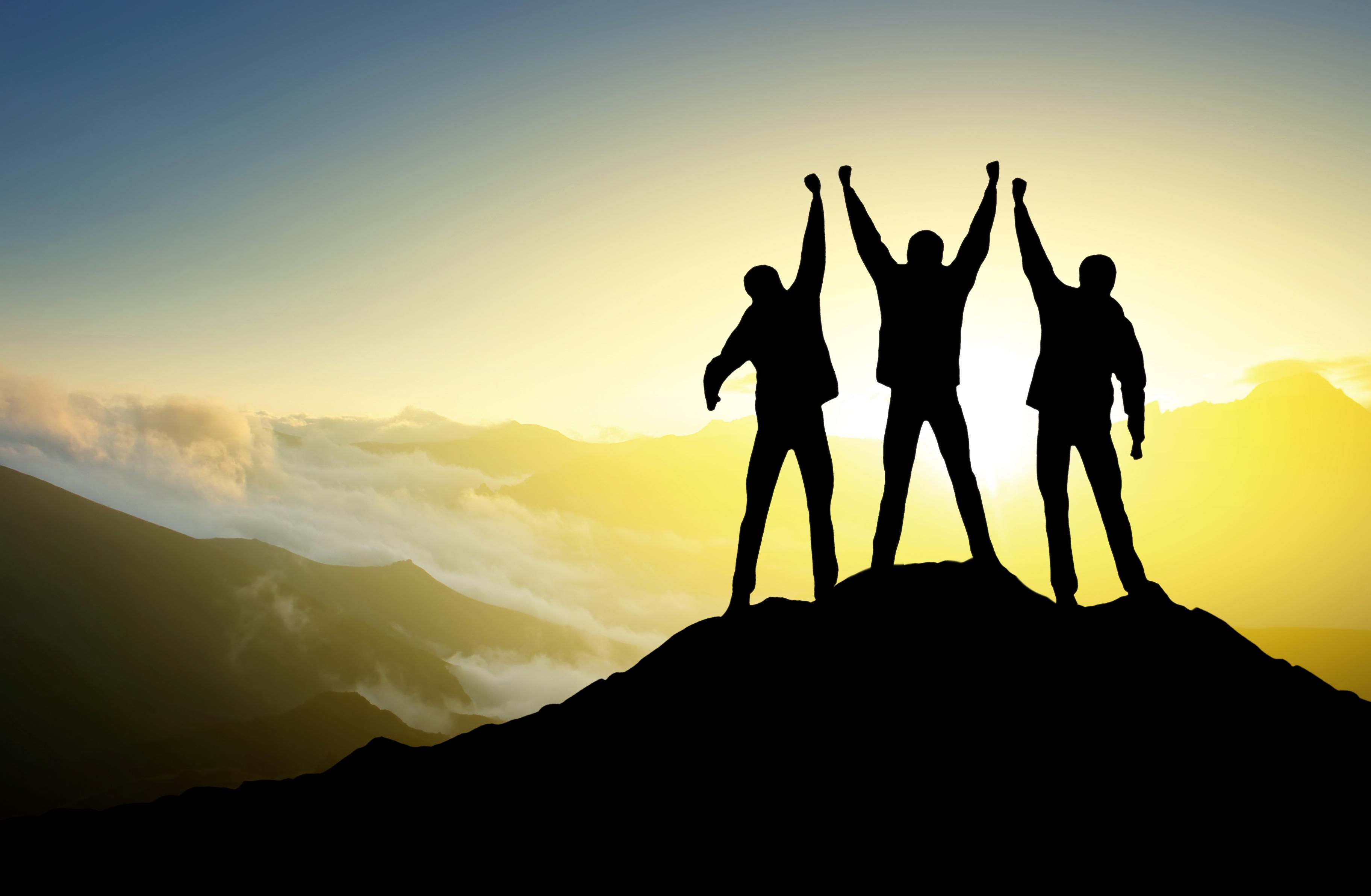 three_people_on_mountain_shutterstock_113099116.jpg
