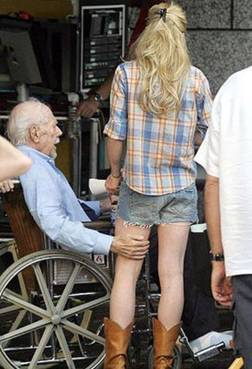 old-man-with-hand-on-young-lady.jpg