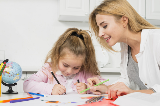 mother-helping-daughter-with-her-homework_23-2147997769.jpg