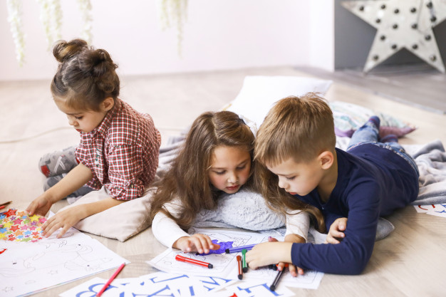 three-focused-children-are-playing-floor-drawing-coloring-books_8353-10845.jpg