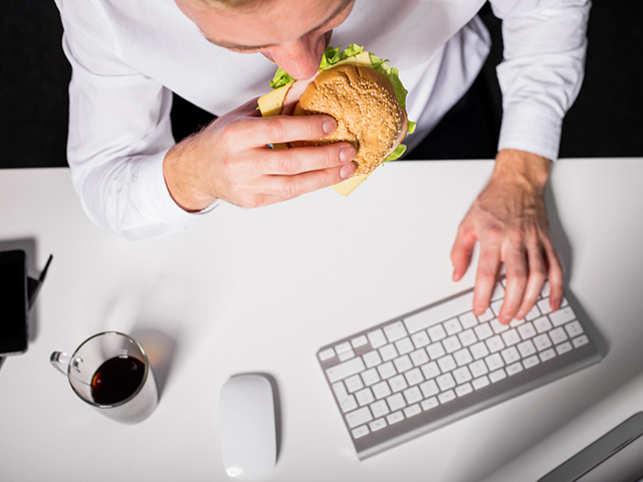 stress-eating-food-work-office-burger-gettyimages-518905244.jpg