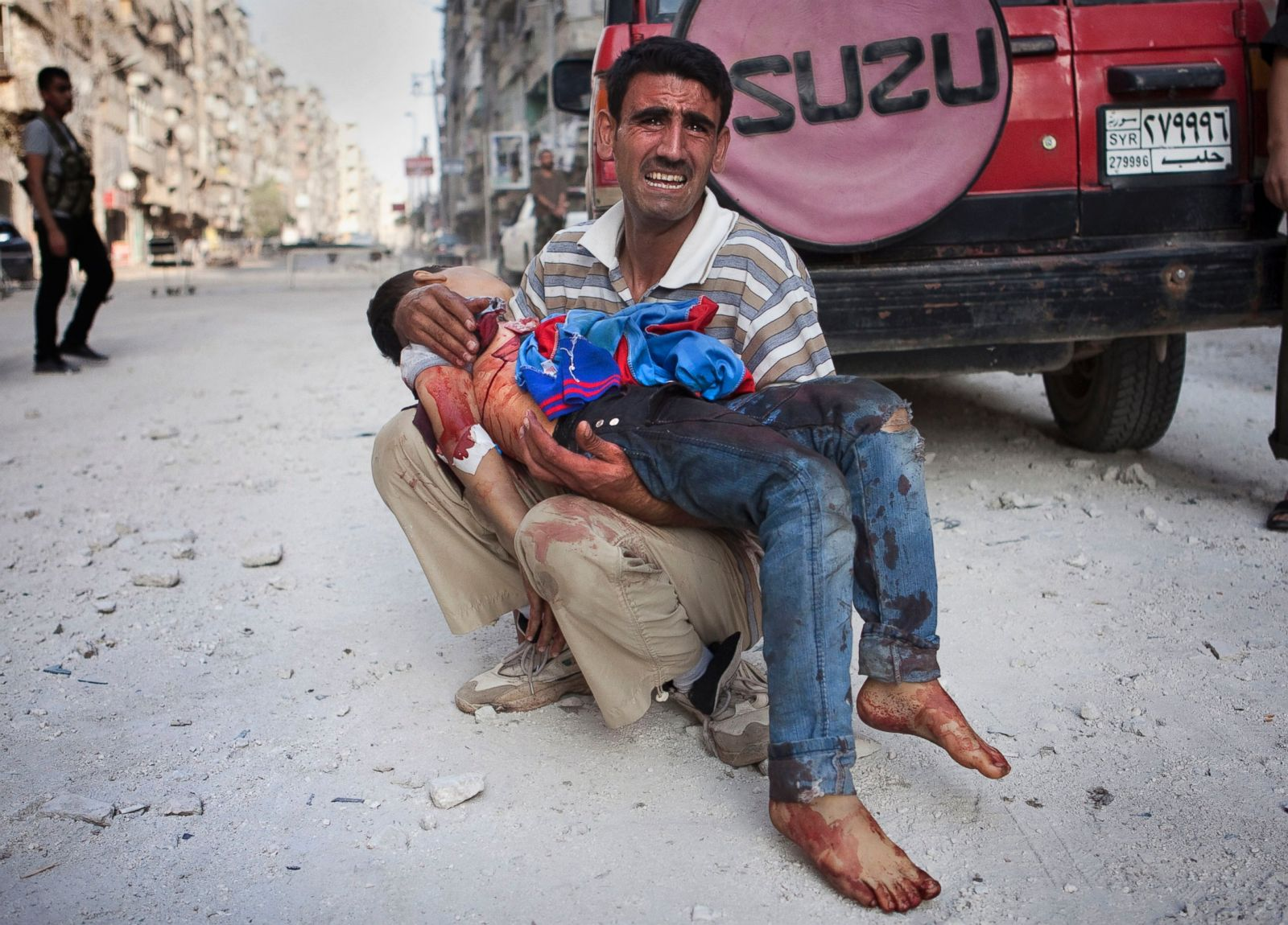 syria_father_dead_child.jpg