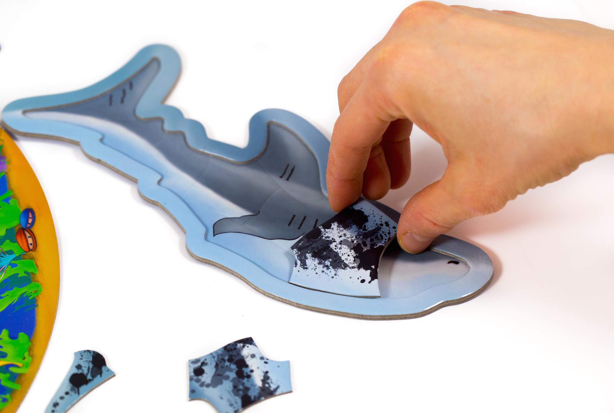 Az ügyes megtaláló jutalma: a cápába illeszthet egy darabot.