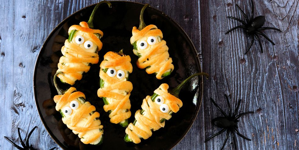 halloween-mummy-jalapeno-poppers-top-view-on-dark-royalty-free-image-1030151254-1540312538.jpg