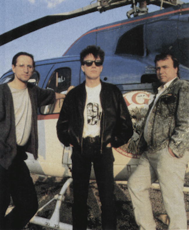 the-bitmap-brothers-standing-by-robert-maxwells-helicopter.png