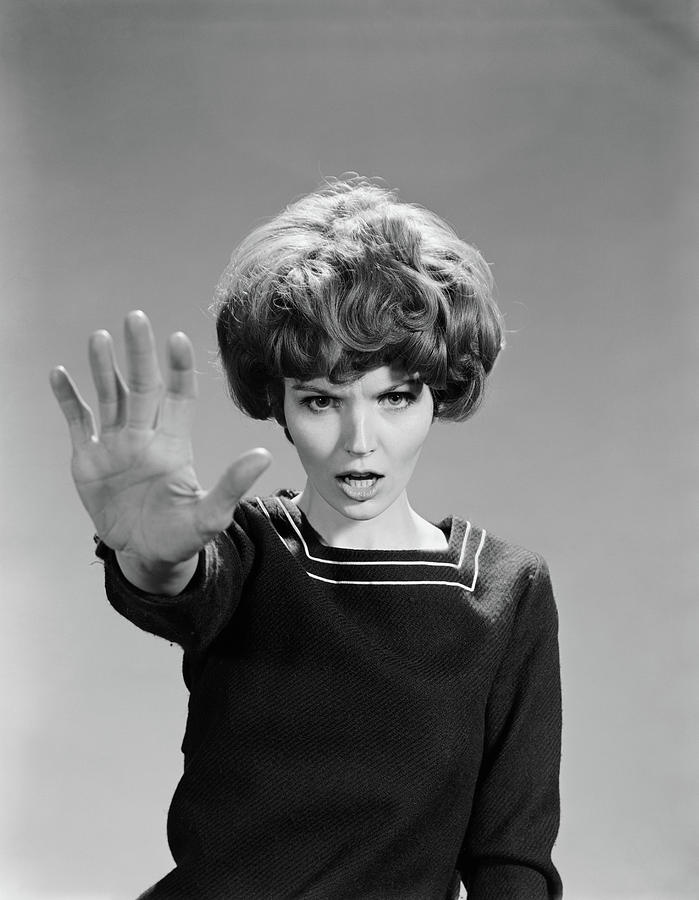 1960s-angry-woman-hand-held-out-as-stop-vintage-images.jpg