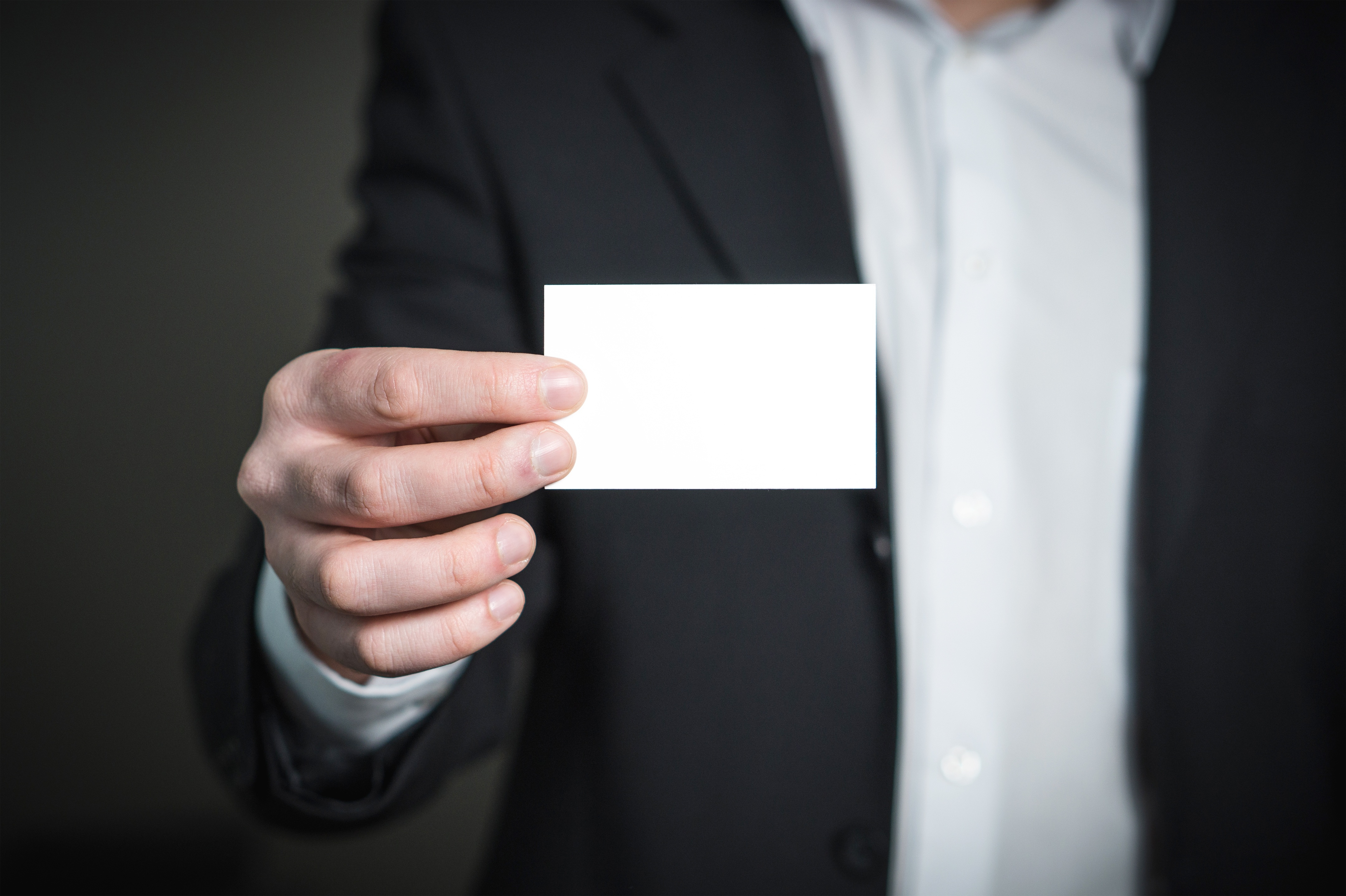 canva_close-up_of_a_person_hand_with_card.jpg