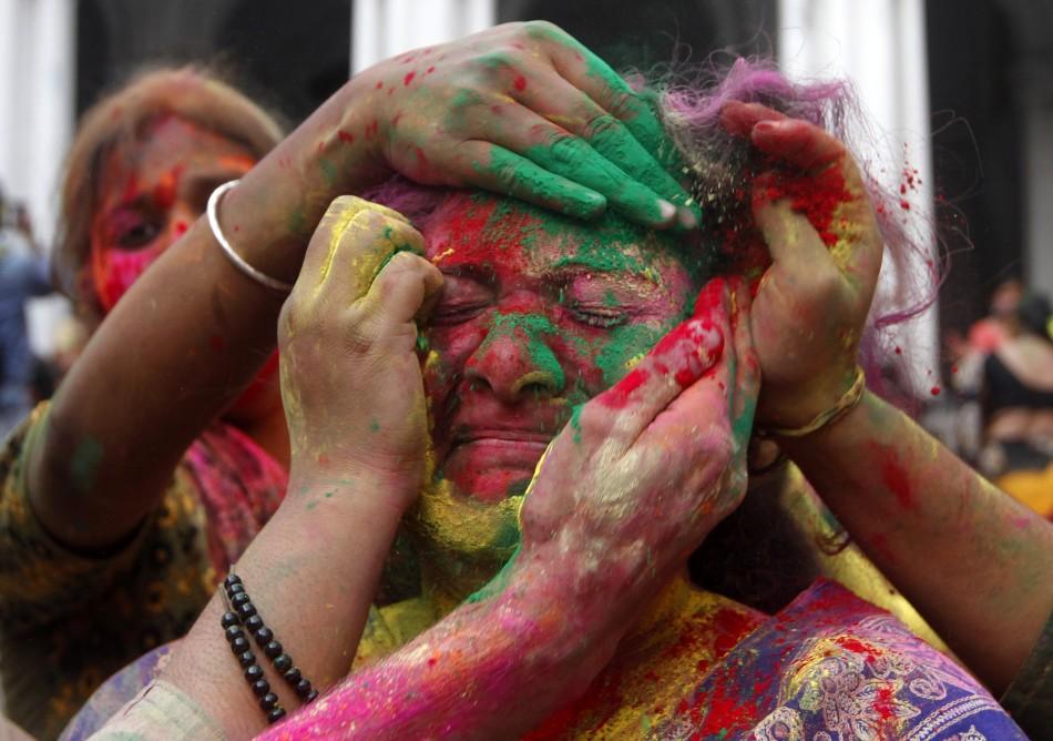 356215-indian-lathmar-holi-festival-barsana-village-uttar-pradesh.jpg