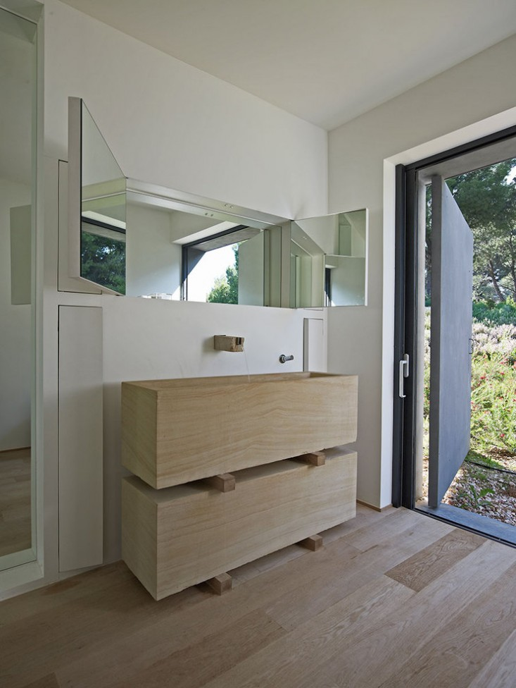Dionisis-Sotovikis-Earth-Light-Bathroom-Open-to-Outdoors-Gardenista.jpg