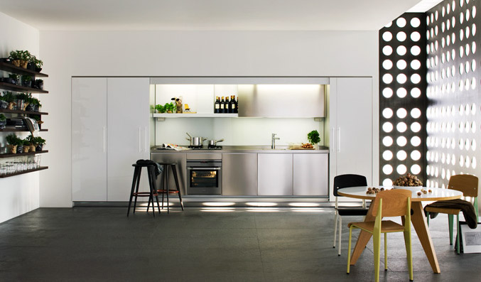White-Kitchen-Design-With-Wooden-Floor-and-Polka-Dot-Wall.jpg
