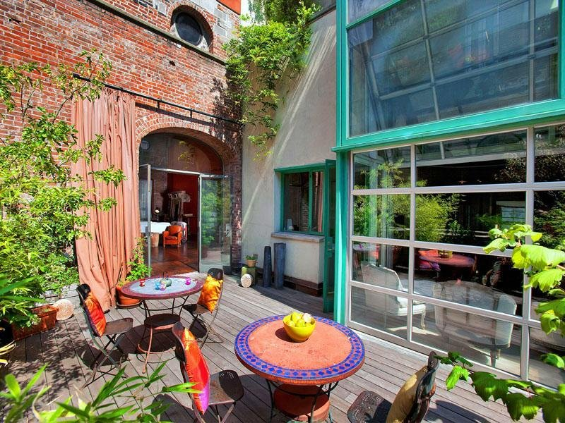 colorful-outdoor-seating-area-serves-sunny-city-oasis.jpeg