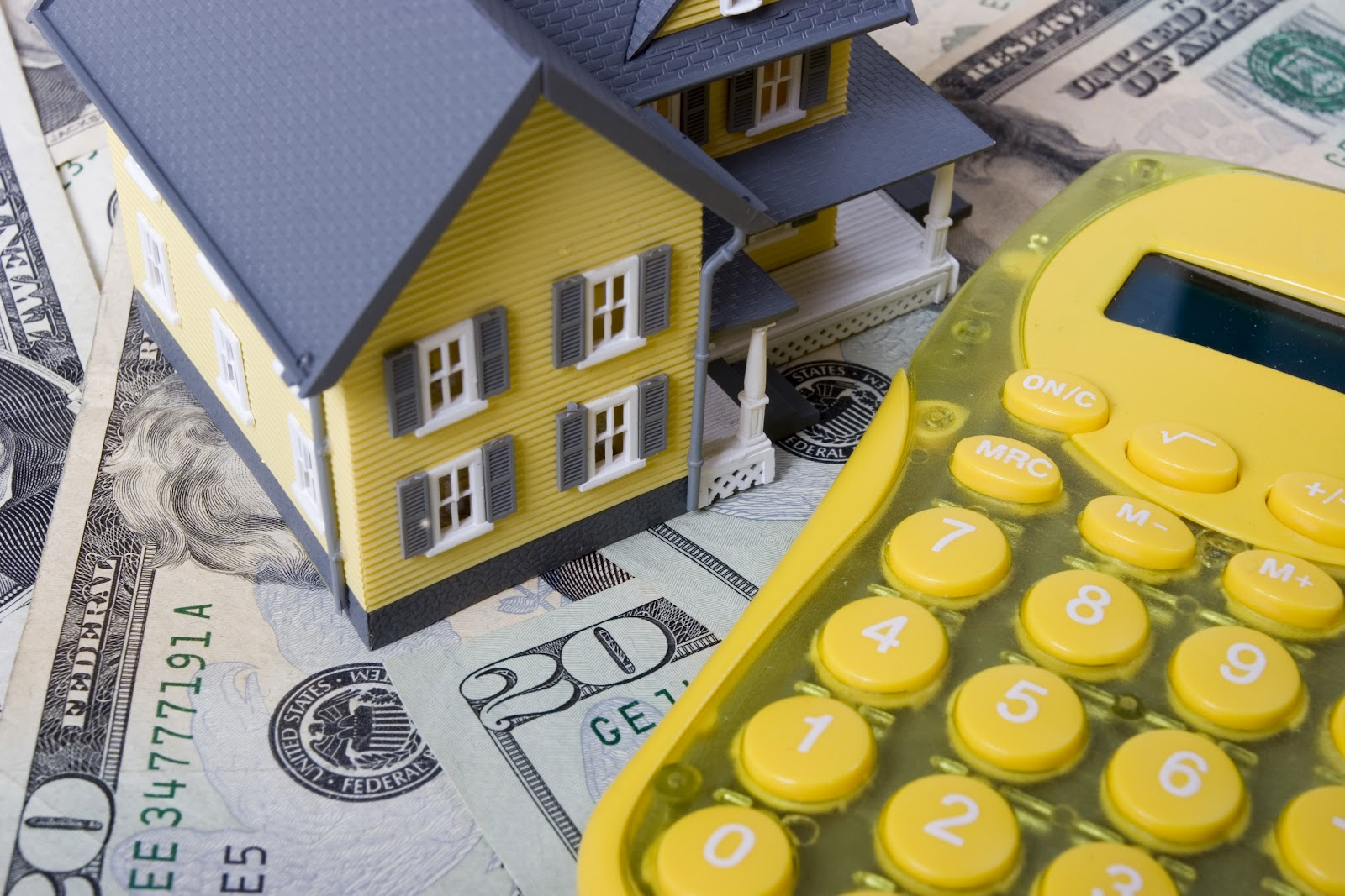 iStock_000002303404Large - House on money with calc.jpg