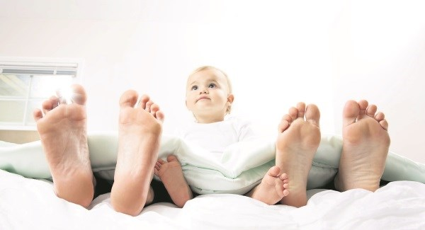 babybetweenparentsfeet_large.jpg