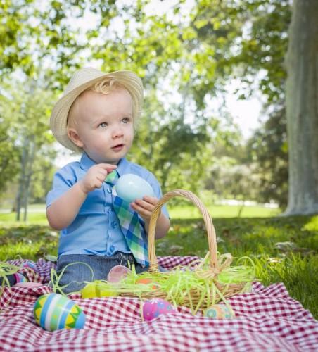 cute-little-boy-enjoying-his-easter-eggs-outside-in-park1.jpg