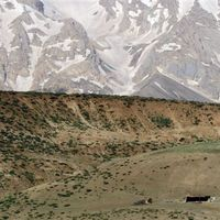 Layers of Zagros mountains with nomadic tent