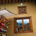 windows and puppets in Masuleh, the tourist village in Gilan province