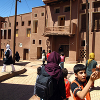 Abyaneh, iranian tourists in the pink village
