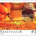 Kacskaringós betűkkel íródó levél osztrák bélyegen