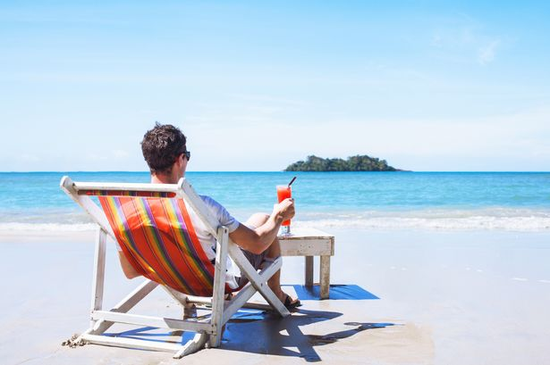 -1relaxation-tourist-with-cocktail-beach-holidays.jpg