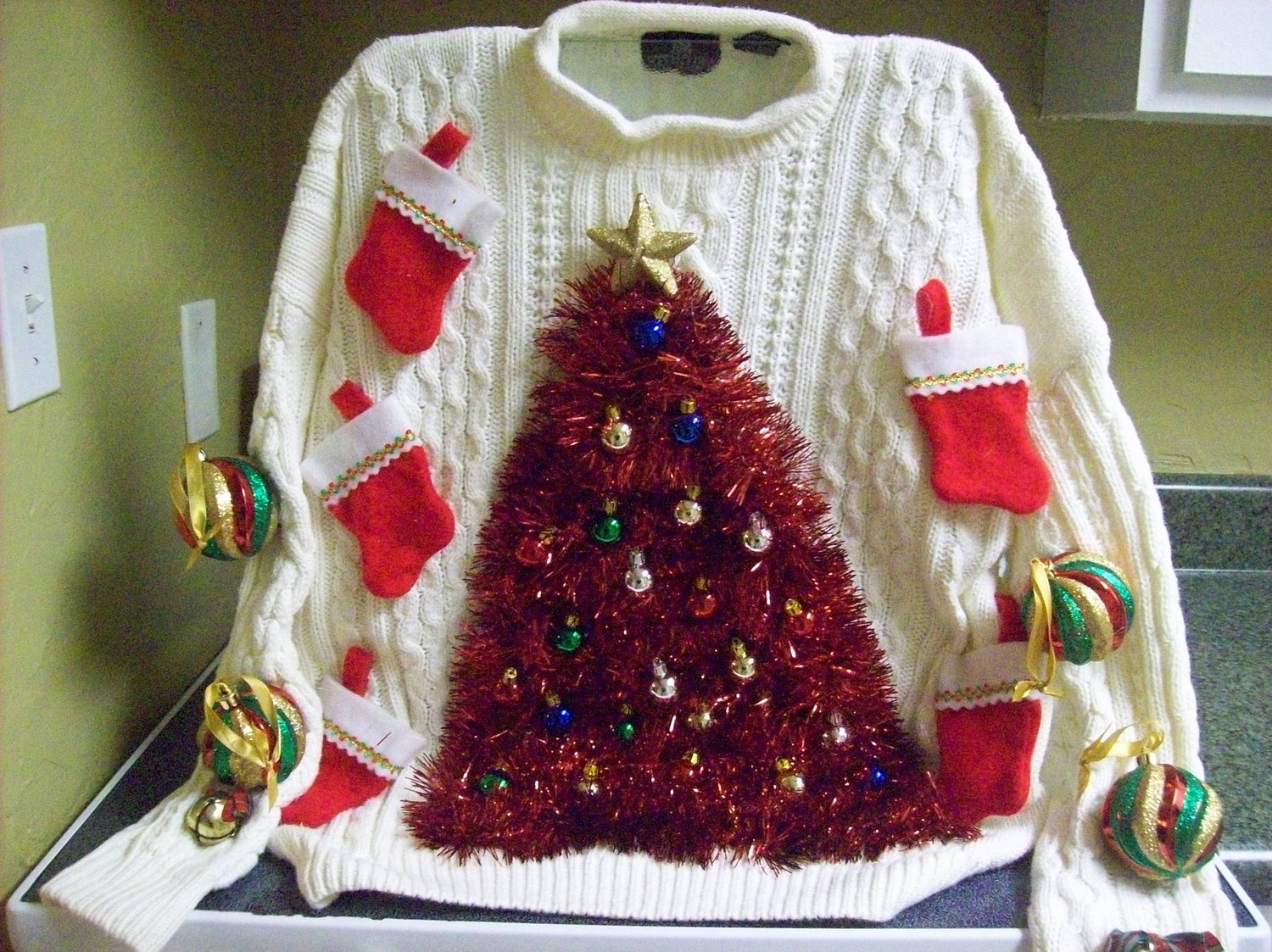 ugly-christmas-sweater-09-tree-made-from-tinsel-and-christmas-stockings.jpg