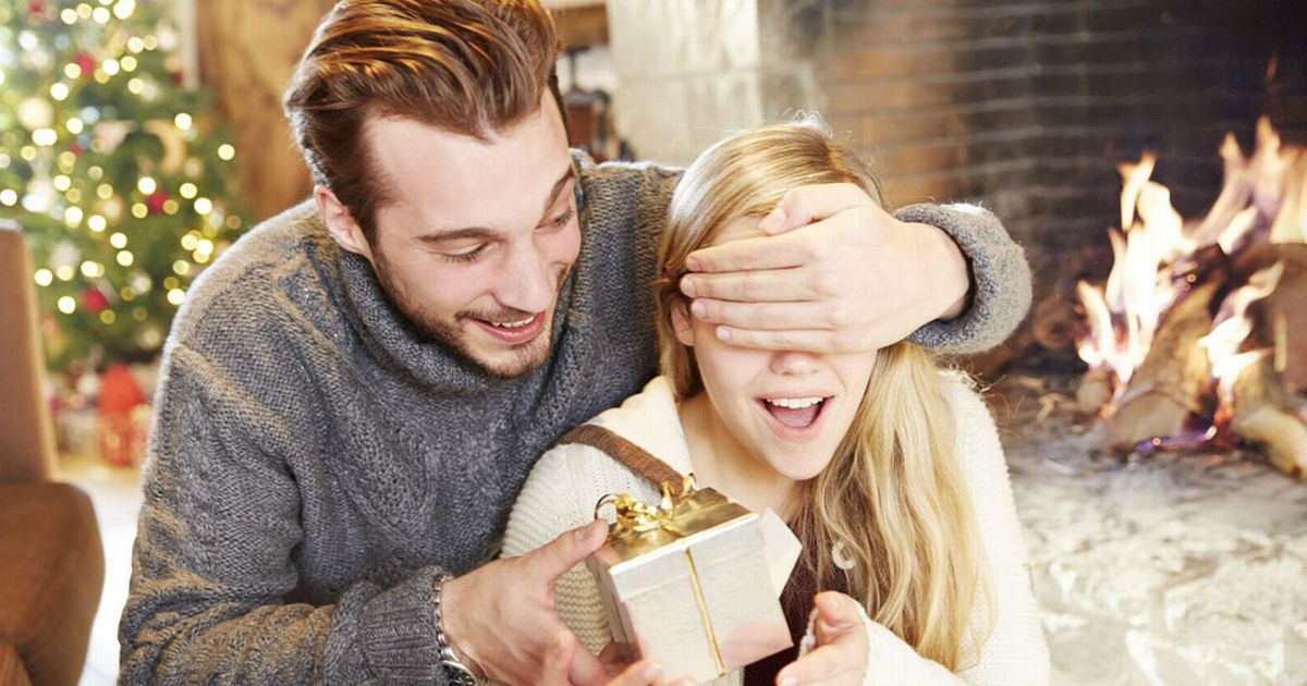 couple-exchanging-gifts-on-christmas.jpg