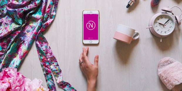 web3-natural-cycles-nfp-contraception-app-hand-phone-lay-flat-natural-cycles-via-facebook-fair-use.jpg