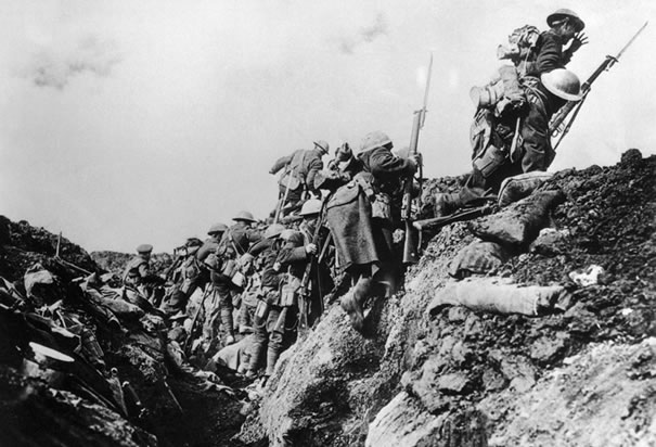 canadian-soldiers-going-over-trench.jpg