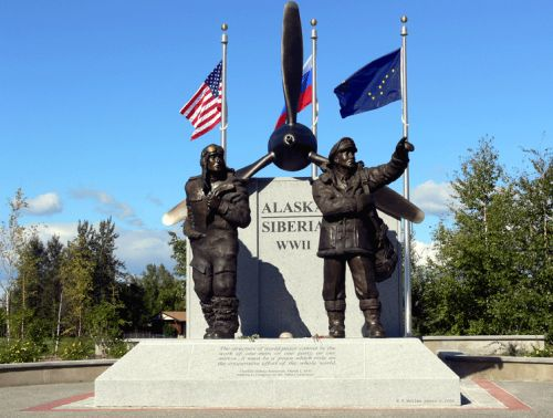 e-aksib-monument-with-flags.jpg