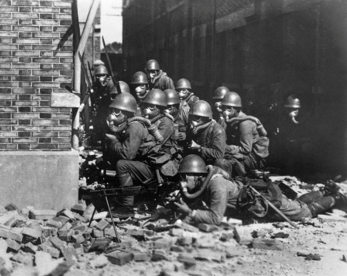 japanese_special_naval_landing_forces_with_gas_masks_and_rubber_gloves_during_a_chemical_attack_battle_of_shanghai_1937.jpg