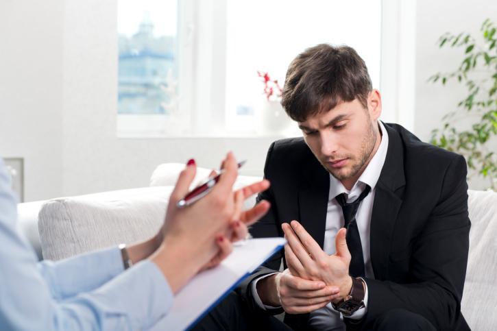 man-speaking-with-therapist.jpg