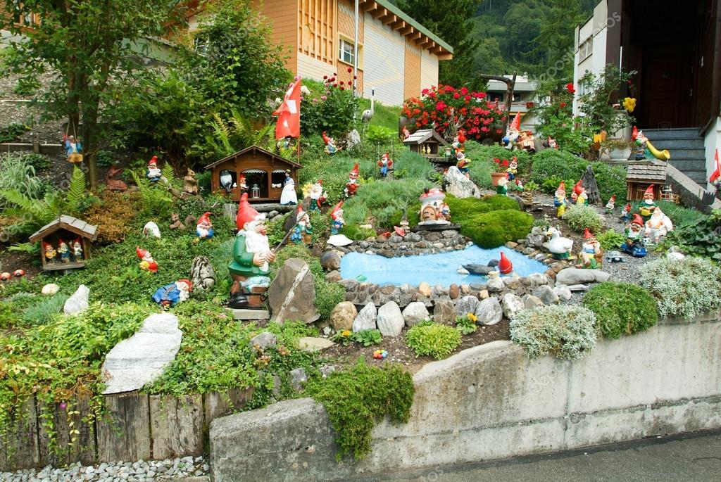 depositphotos_76543067-stock-photo-garden-gnomes-in-a-garden.jpg