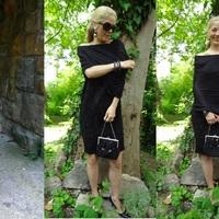 Egy fekete szoknya- ruha több funkcióban