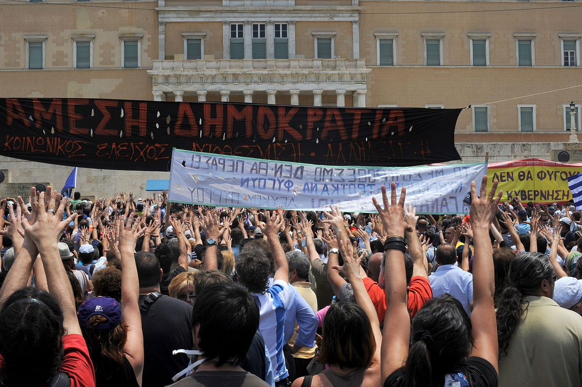 1200px-20110629_moutza_demonstrations_greek_parliament_athens_greece.jpg