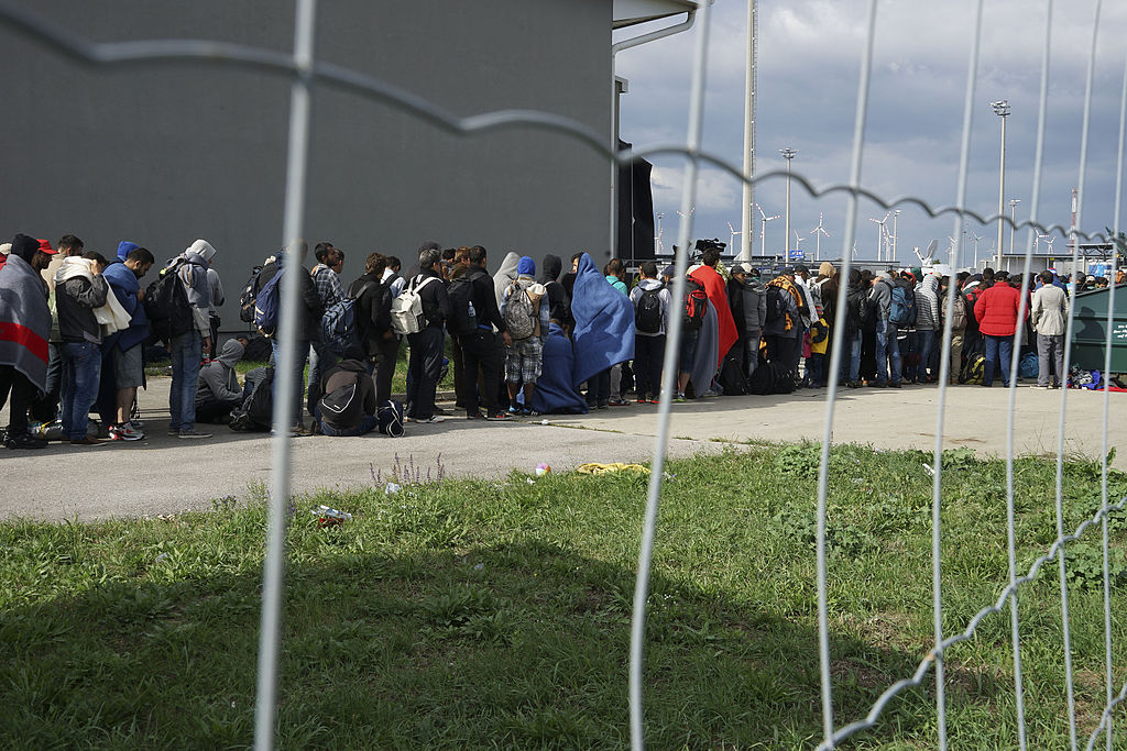 a_line_of_syrian_refugees_crossing_the_border_of_hungary_and_austria_on_their_way_to_germany_hungary_central_europe_6_september_2015.jpg