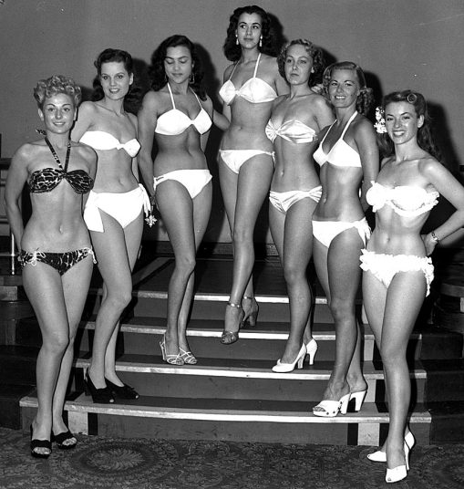 1951 The finalists in the first ever Miss World contest pose in their bikinis in the Empire Rooms on Tottenham Court Road, London.jpg