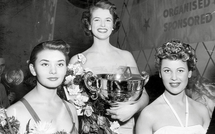 1952 May Louise Flodin, Sweden, won the silver punch bowl from runners-up Miss Switzerland Sylvia Muller (left) and Miss Germany Vera Marks.jpg
