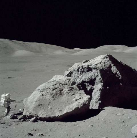Scientist-Astronaut Harrison H. Schmitt is photographed standing next to a huge, split boulder during the third Apollo 17 extravehicular activity (EVA-3) at the Taurus-Littrow landing site on the Moon. Schmitt is the Apollo 17 lunar module pilot. This picture was taken by Astronaut Eugene A. Cernan, commander.