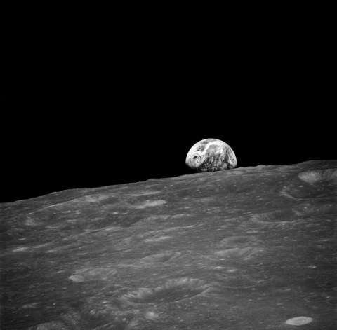 The first photograph taken by humans of Earthrise. Taken by Apollo 8 crewmember Bill Anders on December 24, 1968
