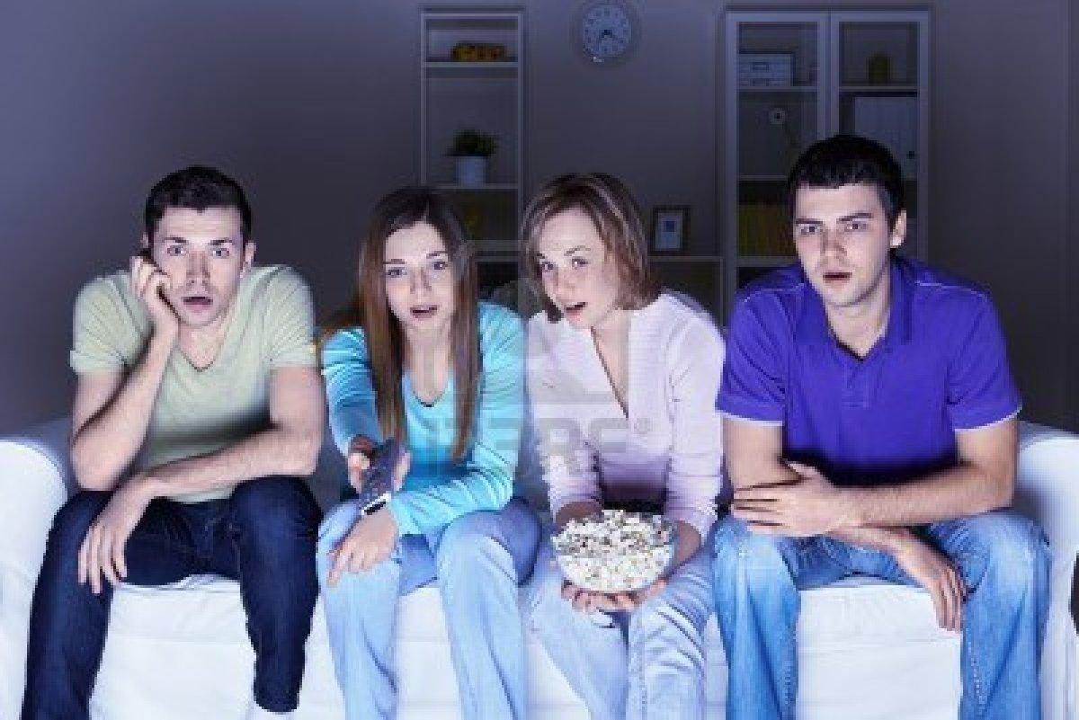 9075350-surprised-people-are-watching-a-movie.jpg