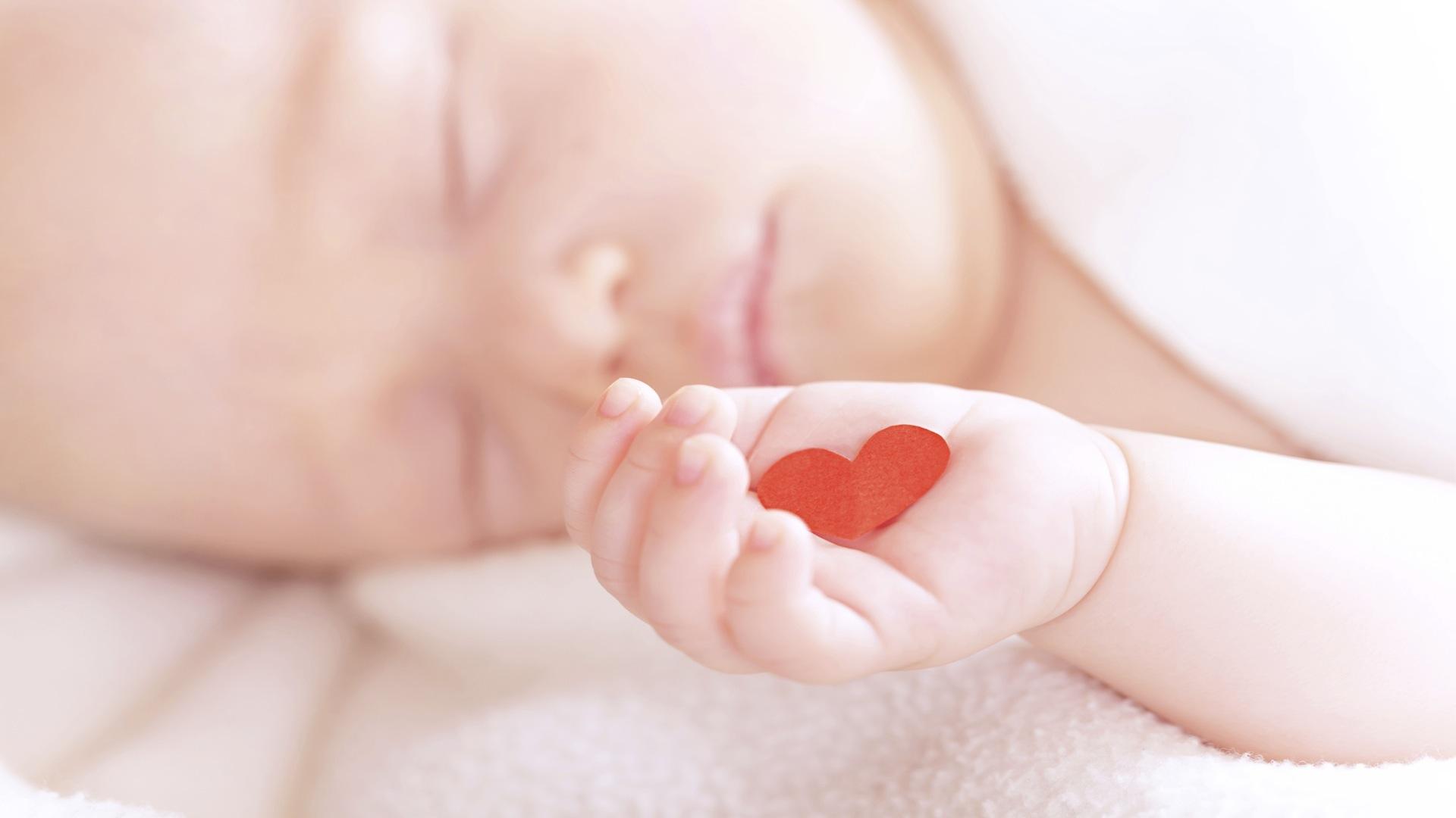 newborn-baby-girl-with-heart.jpg