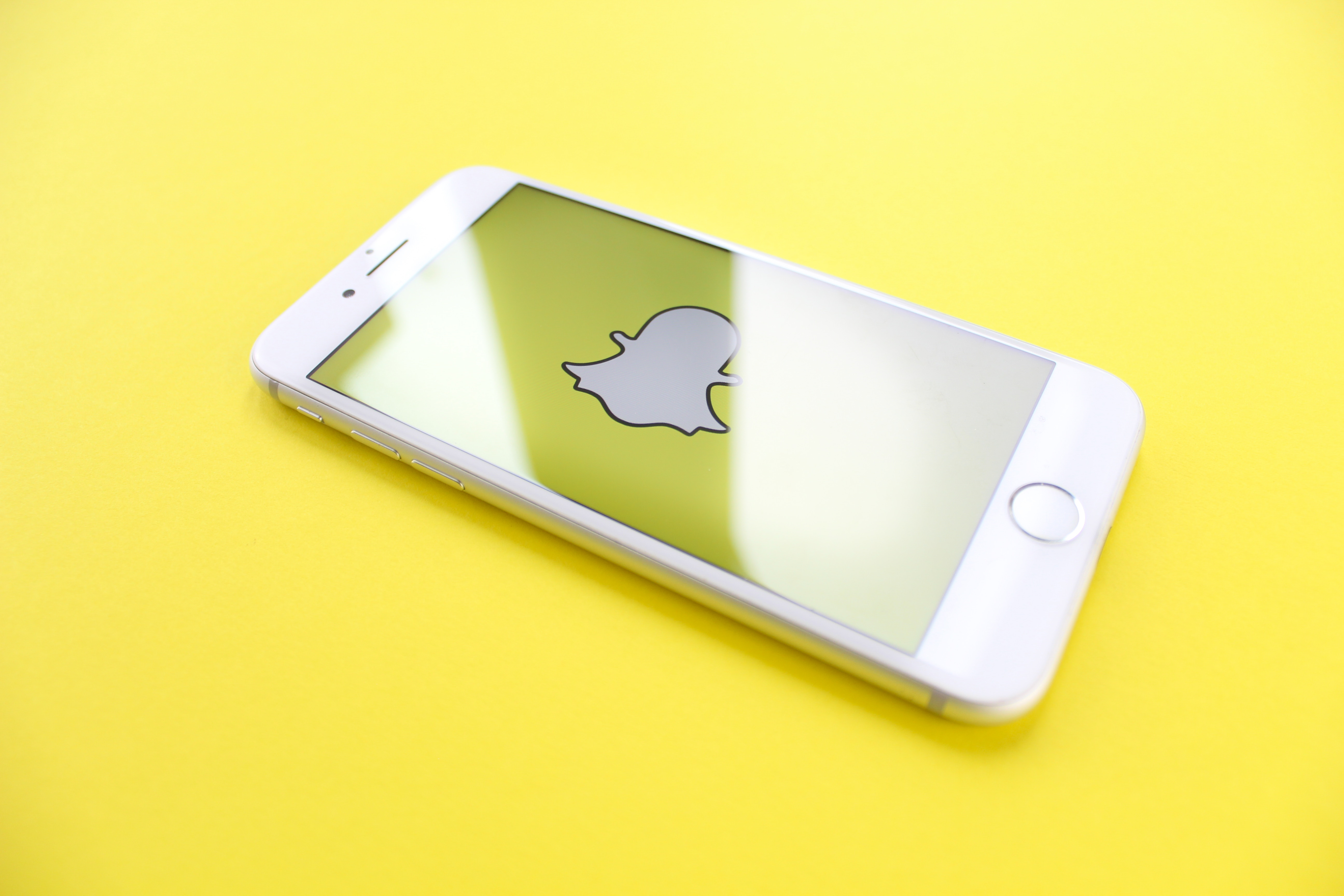 iphone-on-yellow-surface-2228569.jpg