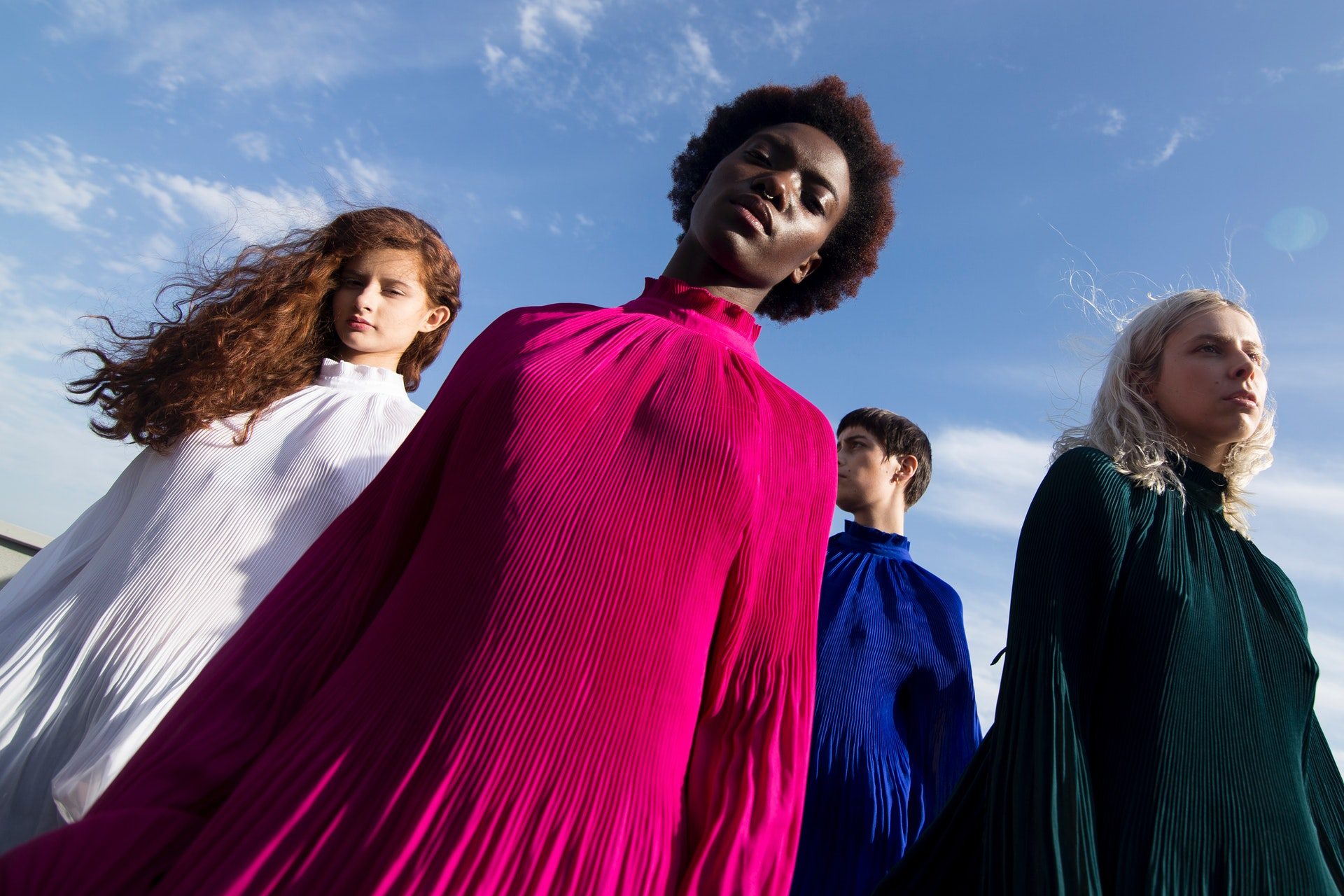 low-angle-photography-of-four-women-in-assorted-color-long-1034361.jpg