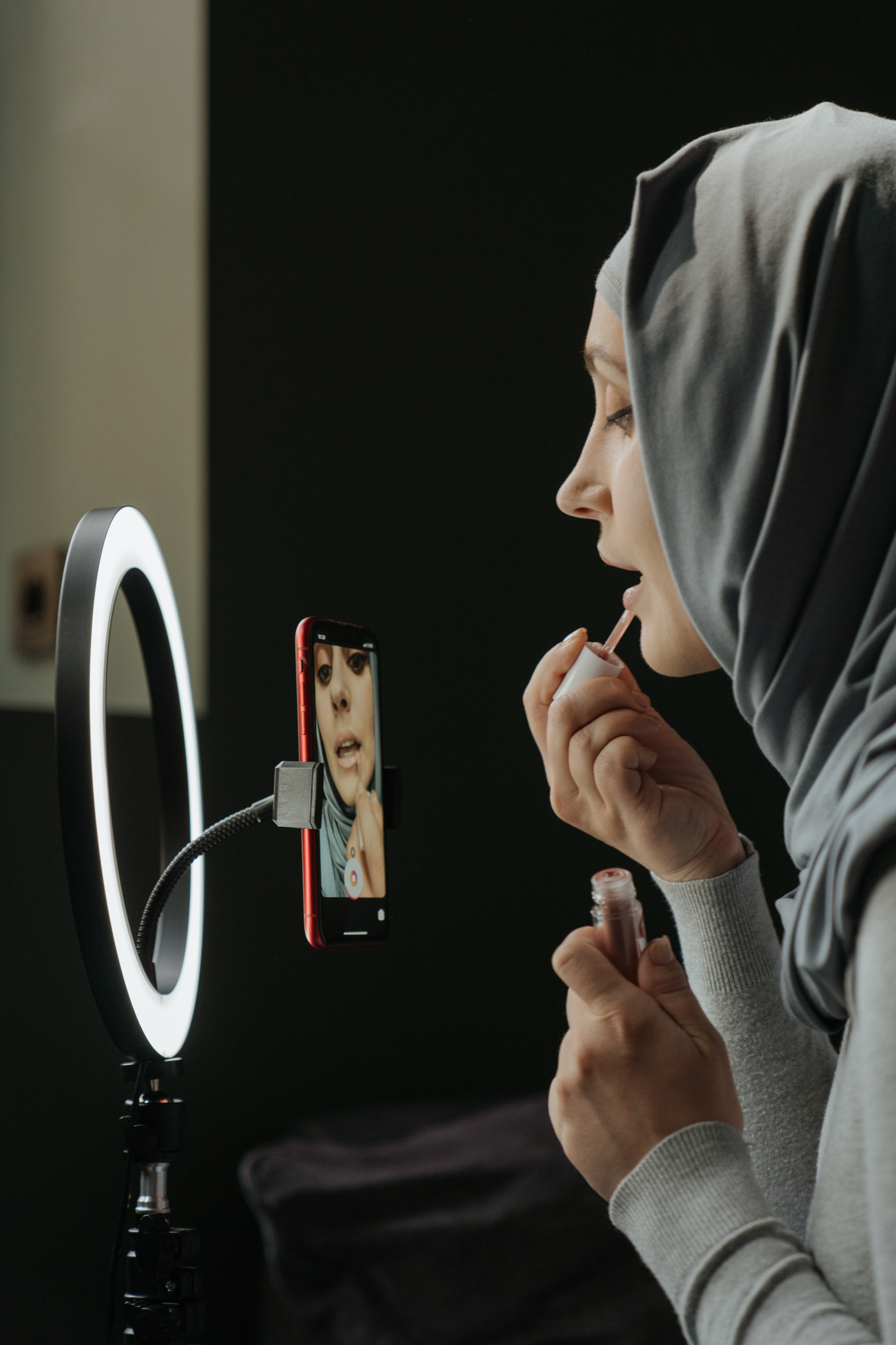 woman-in-gray-hijab-holding-iphone-4620809.jpg