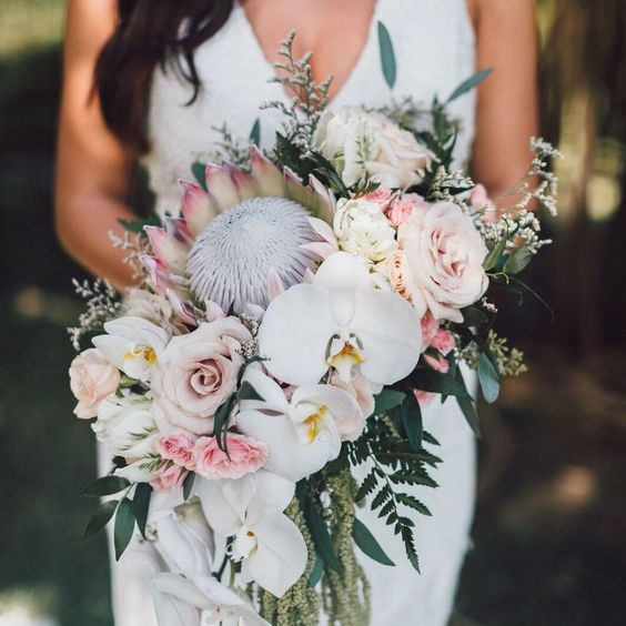 21-a-unqiue-tropical-wedding-bouquet-with-king-proteas-blush-and-mauve-roses-greenery-and-white-orchids.jpg