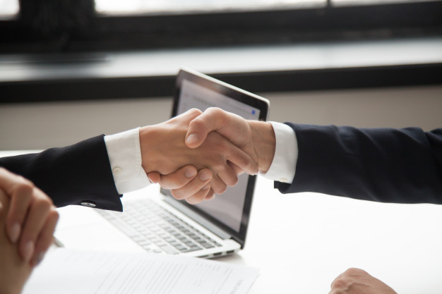 businessman-handshaking-businesswoman-showing-respect-closeup-view-hands-shaking_1163-4679.jpg