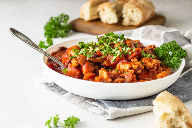 meat-stew-with-red-beans-bell-pepper-onion-tomato-sauce-white-plate-light-grey-slate_132278-534.jpg