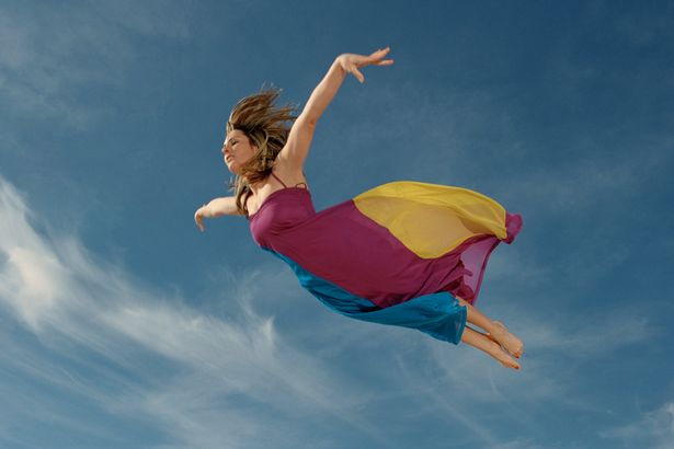 woman-flying-through-sky-side-view-1761303.jpg