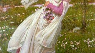 Gyümölcsöt szedni egy nő öléből