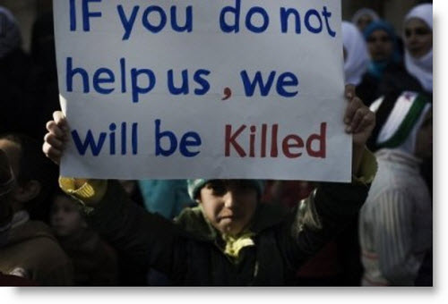 syria-massacre-child-with-sign-for-help.jpg