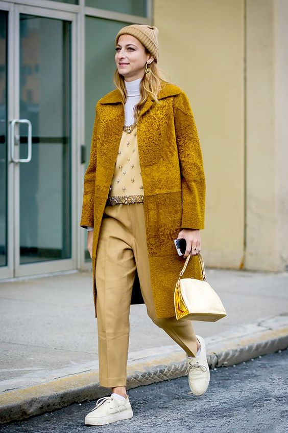 04-a-monochromatic-outfit-with-pale-yellow-pants-an-embellished-top-a-white-turtleneck-a-mustard-fur-coat-and-neutral-sneakers.jpg